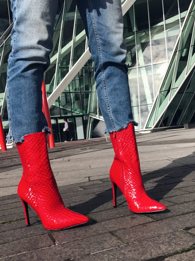 prince of wales check blazer, baker boy cap, statement wide belt, belt over blazer, red patent boots,